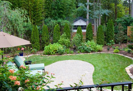 Custom landscape design in Charlotte includes lawns and hardscaping.