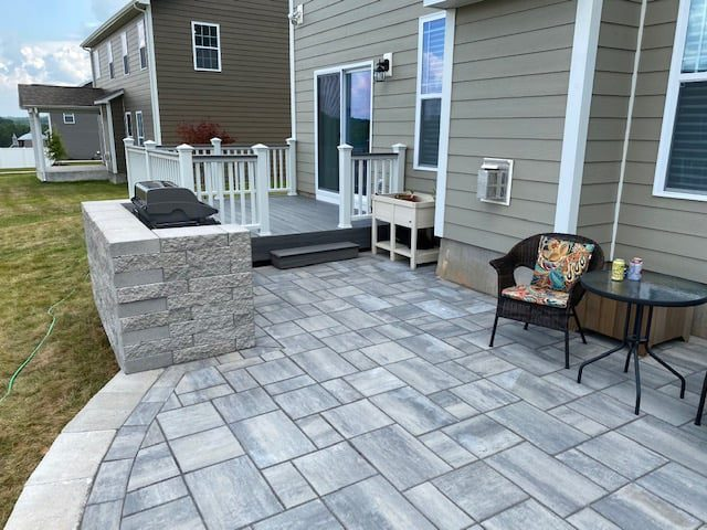 Outdoor living project with a deck and custom patio