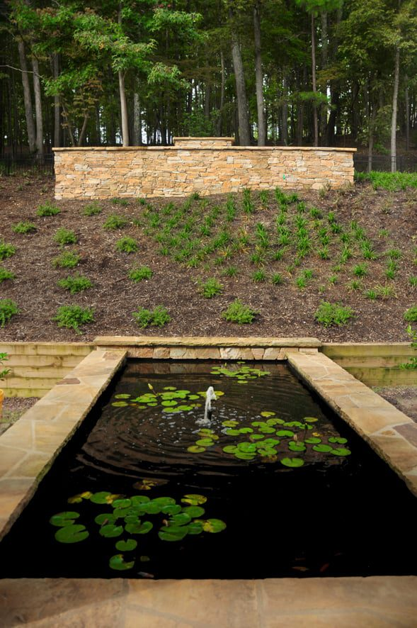 Japanese-style landscape with pond and natural stone hardscaping in Charlotte