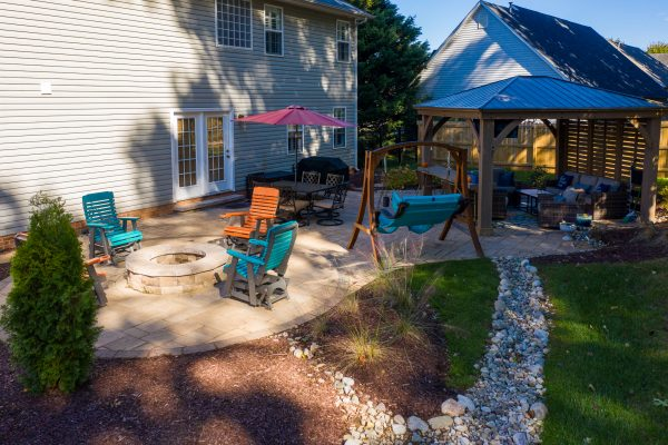Outdoor living space with custom patio and drainage Huntersville NC | MetroGreenscape
