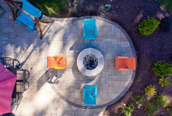 birds-eye view of paver patio and fireplace with colorful outdoor furniture