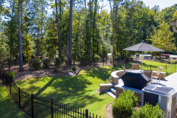 paver patio with steps leading into lush, green lawn by MetroGreenscape