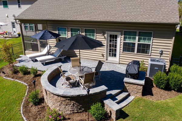 Outdoor patio with built-in seating wall in South Carolina