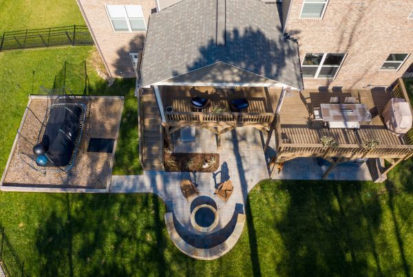 Beautiful backyard with a patio, fireplace and second-story deck in Huntersville NC