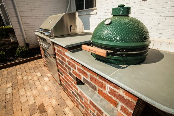 Brick outdoor kitchen with a grill and Big Green Egg