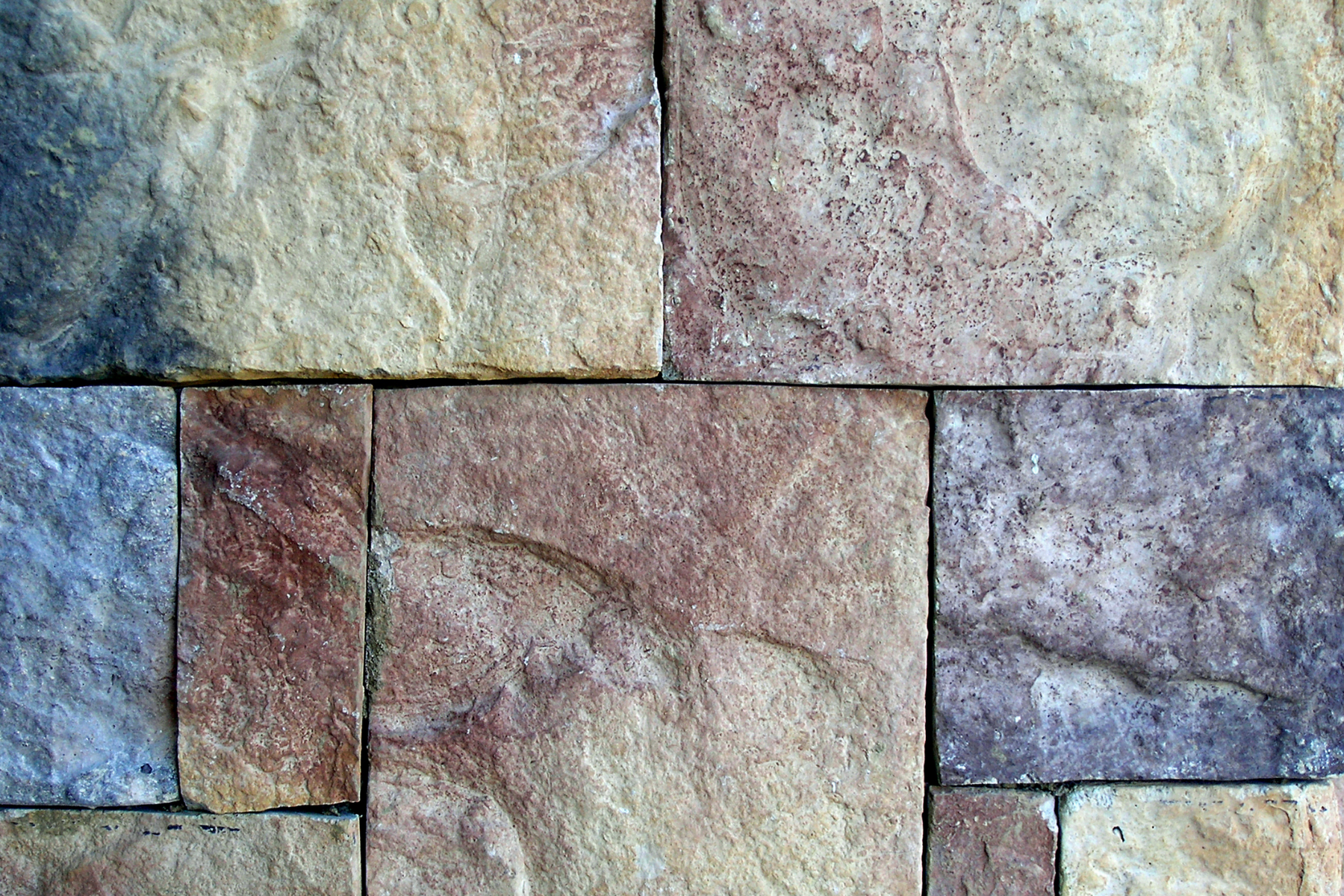 Many homeowners use flagstone when landscaping with rock