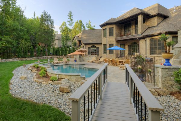 Luxury outdoor living with drainage, patio, walkways and a beautiful pool