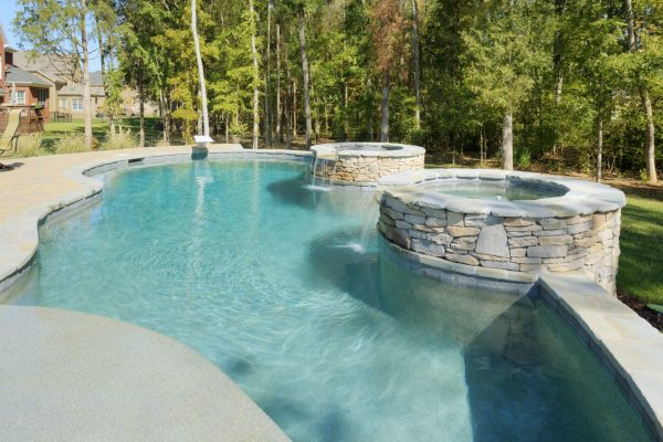 Pool with water features designed by MetroGreenscape