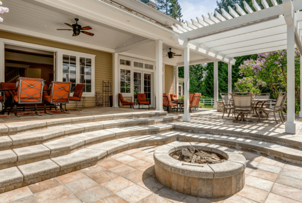 Large outdoor living space with a pergola and fire pit for entertaining